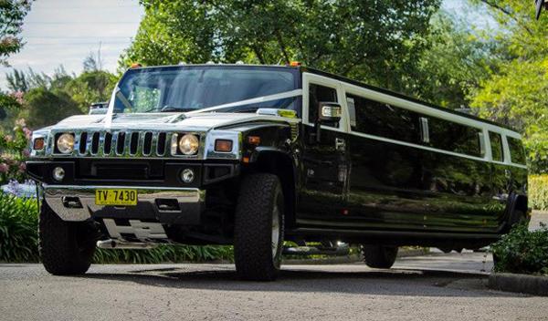18 Seater H2 Hummer Limo Sydney, H2 Hummer Limo Hire Sydney black and white hummer h2 limo sydney